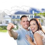Couple with keys to their home