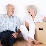retirees with boxes, moving