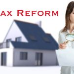 Woman looking at a paper with House and words Tax Reform